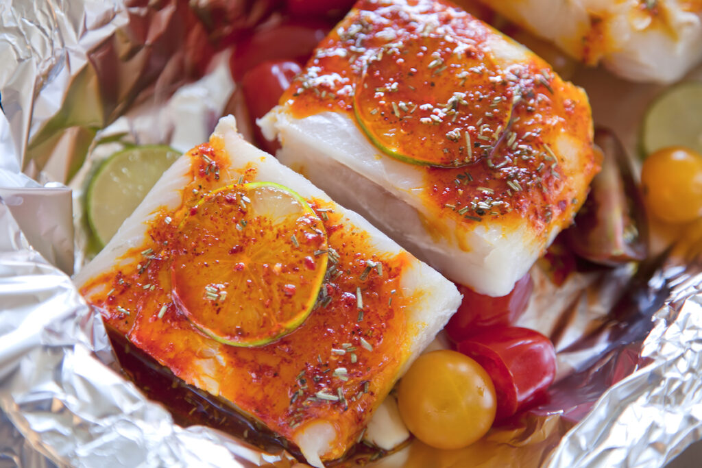 fish and vegetables in a tin foil hobo packet