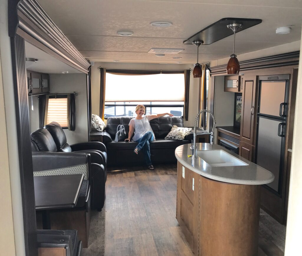 RV living room with woman sitting on couch