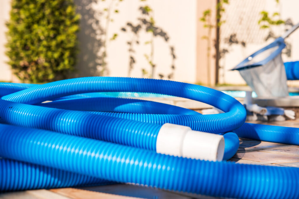 blue pool tubing for cleaning on patio