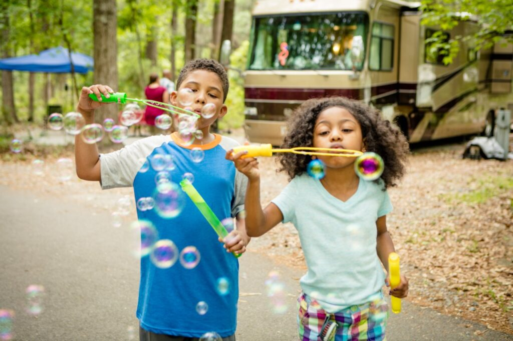 two kids blowing bubbles in RV campground near atlanta ga