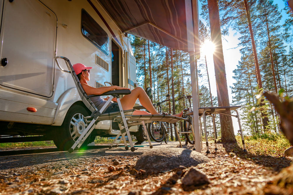 RV Site with person relaxing in chair
