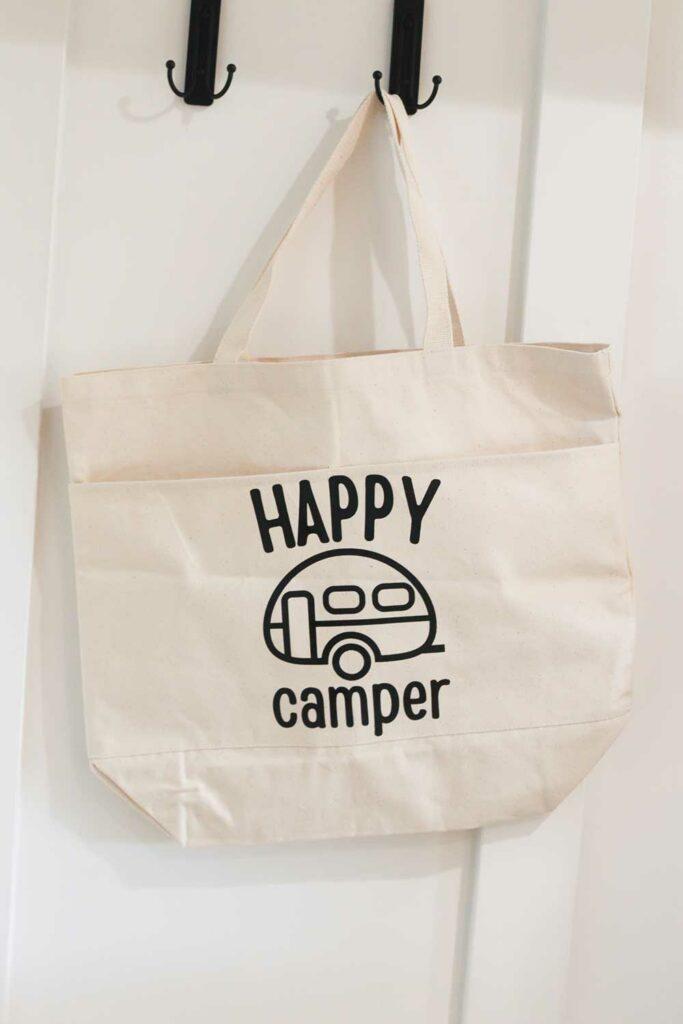 Happy Camper SVG hanging on wall hook