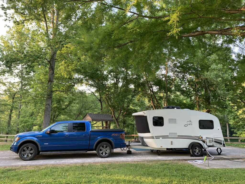 Intech sol horizon and blue truck in campsite